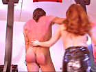 Latex Mistress whipping and teasing young male slave